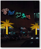 Restaurants capitalize on the new business these lighted Palm Trees bring in